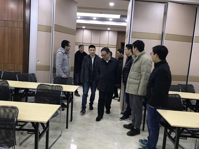 Zhong Yu, deputy district head of Dadukou District government and his delegation visited the company for investigation